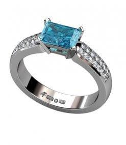 diamantring med blå topas i vitguld