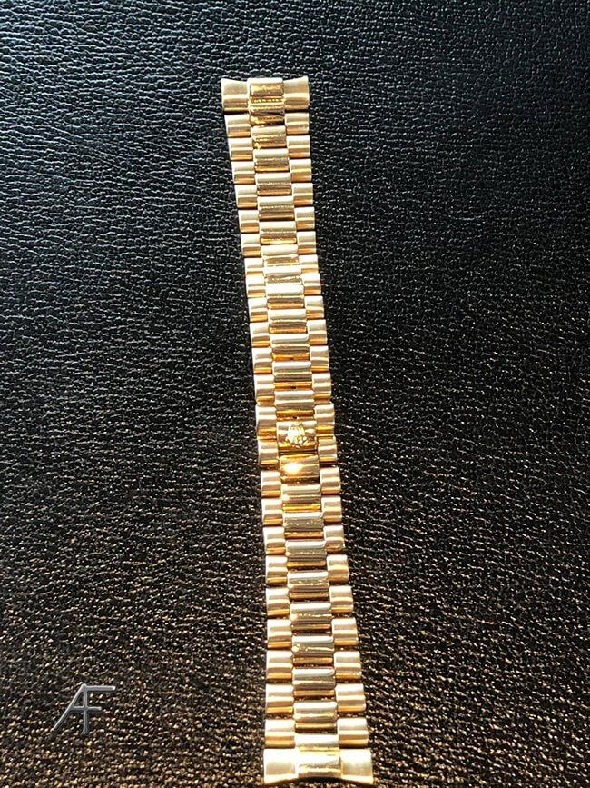 renovering av guldrolex armband