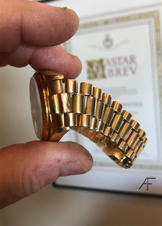 stretchad rolexlänk guld