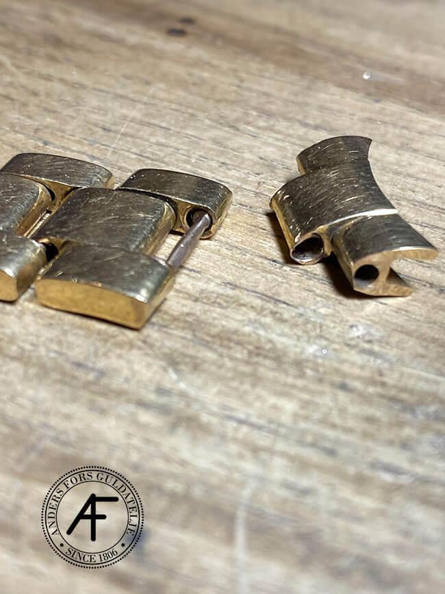 slitna stift på Rolex länk i guld
