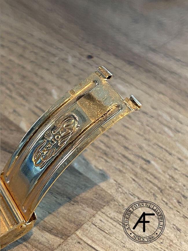 trasigt gångjärn guldrolex
